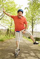 fat man exercising - Clumsy man riding a scooter Stock Photo - Premium Royalty-Freenull, Code: 673-02142347