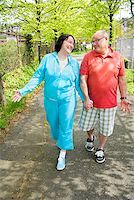 fat man exercising - Couple walking outside Stock Photo - Premium Royalty-Freenull, Code: 673-02142348