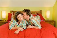 Kissing couple wearing matching pajamas Stock Photo - Premium Royalty-Freenull, Code: 673-02142367