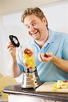 Man making a smoothie Stock Photo - Premium Royalty-Freenull, Code: 673-02142408
