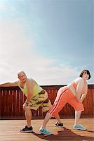 fat man exercising - Couple stretching on patio Stock Photo - Premium Royalty-Freenull, Code: 673-02142459