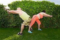 fat man exercising - Couple stretching in backyard Stock Photo - Premium Royalty-Freenull, Code: 673-02142461