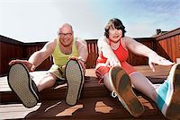 fat man exercising - Couple stretching on patio Stock Photo - Premium Royalty-Freenull, Code: 673-02142463