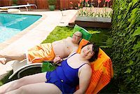 fat woman in bathing suit - Couple relaxing on lawn chairs in backyard Stock Photo - Premium Royalty-Freenull, Code: 673-02142469