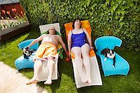 fat woman in bathing suit - Couple relaxing on lawn chairs in backyard Stock Photo - Premium Royalty-Freenull, Code: 673-02142472