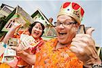 Couple wearing festive outfits and crowns Stock Photo - Premium Royalty-Free, Artist: Ikon Images, Code: 673-02142492