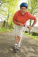fat man exercising - Man riding a scooter Stock Photo - Premium Royalty-Freenull, Code: 673-02142526