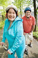 fat man exercising - Couple riding scooters together Stock Photo - Premium Royalty-Freenull, Code: 673-02142547