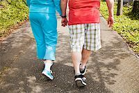 fat man exercising - Couple walking together outside Stock Photo - Premium Royalty-Freenull, Code: 673-02142552