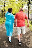 fat man exercising - Couple walking together outside Stock Photo - Premium Royalty-Freenull, Code: 673-02142553