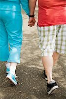 fat man exercising - Couple walking together outside Stock Photo - Premium Royalty-Freenull, Code: 673-02142554