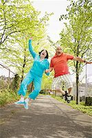 fat man exercising - Couple jumping for joy outside Stock Photo - Premium Royalty-Freenull, Code: 673-02142556