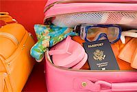Packed suitcase Stock Photo - Premium Royalty-Freenull, Code: 673-02142764