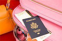 Passport on packed suitcase Stock Photo - Premium Royalty-Freenull, Code: 673-02142768