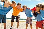 Male camp counselor and children in huddle Stock Photo - Premium Royalty-Free, Artist: Zoran Milich, Code: 673-02142935