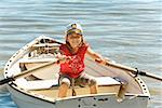 Young girl in row boat Stock Photo - Premium Royalty-Freenull, Code: 673-02142963