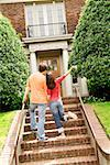 Hispanic couple walking towards house Stock Photo - Premium Royalty-Free, Artist: Masterfile, Code: 673-02143029