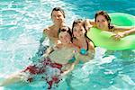 Family in swimming pool Stock Photo - Premium Royalty-Free, Artist: Tim Mantoani, Code: 673-02143074