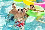 Family in swimming pool Stock Photo - Premium Royalty-Free, Artist: Dan Lim, Code: 673-02143075