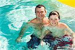 Father and son in swimming pool Stock Photo - Premium Royalty-Free, Artist: Kevin Dodge, Code: 673-02143076