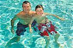 Father and son in swimming pool Stock Photo - Premium Royalty-Free, Artist: Tim Mantoani, Code: 673-02143077
