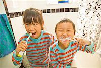 Asian siblings brushing teeth Stock Photo - Premium Royalty-Freenull, Code: 673-02143877