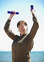 Mature woman exercising with hand weight Stock Photo - Premium Royalty-Freenull, Code: 635-02152428