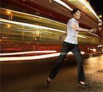 Businesswoman running with lights streaking behind Stock Photo - Premium Royalty-Freenull, Code: 635-02152673