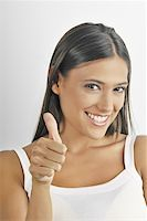 Female young adult;thumbs up Stock Photo - Premium Royalty-Freenull, Code: 644-02152735