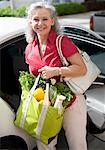 Woman Putting Groceries in Car    Stock Photo - Premium Rights-Managed, Artist: Raoul Minsart, Code: 700-02176476