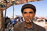 Man with Newspaper Wrapped Cigarette at Sunday Market, Kashgar, Xinjiang Autonomous Region, China    Stock Photo - Premium Rights-Managed, Artist: F. Lukasseck, Code: 700-02194017