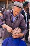 Barber at Sunday Market, Kashgar, Xinjiang Autonomous Region, China