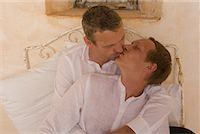 Couple Kissing in Bed    Stock Photo - Premium Rights-Managednull, Code: 700-02198267