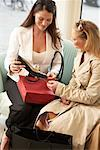 Women Showing Purchases to her Friend    Stock Photo - Premium Rights-Managed, Artist: AL ACCARDO, Code: 700-02198370