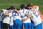Soccer Team Huddling Stock Photo - Premium Royalty-Freenull, Code: 622-02198505