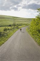 Cyclist on road through hills Stock Photo - Premium Royalty-Freenull, Code: 622-02198541