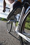 Close-up of a cyclist cycling on road Stock Photo - Premium Royalty-Free, Artist: Ric Frazier, Code: 622-02198598