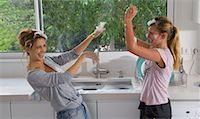 Sisters having bubble soap fight at sink Stock Photo - Premium Royalty-Freenull, Code: 649-02198768