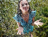 Woman standing in rain Stock Photo - Prem