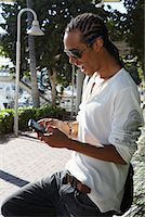 Young Man Sending a Text Message    Stock Photo - Premium Royalty-Freenull, Code: 600-02199794