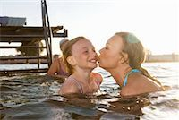 preteen kissing - Mother kissing daughter Stock Photo - Premium Royalty-Freenull, Code: 649-02199709
