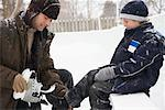 Father Helping Son Put on Skates    Stock Photo - Premium Royalty-Free, Artist: Masterfile, Code: 600-02200079