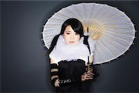 Portrait of Woman With Parasol    Stock Photo - Premium Royalty-Freenull, Code: 600-02200277