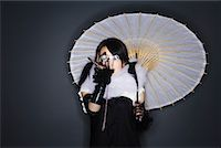 Portrait of Woman With Parasol and Opera Glasses    Stock Photo - Premium Royalty-Freenull, Code: 600-02200278