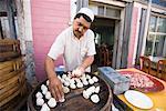 Man Steaming Mantou at Market, Kashgar, Xinjiang Province, China