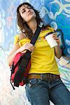 Young Woman with Coffee Leaning Against Wall    Stock Photo - Premium Rights-Managed, Artist: Ty Milford, Code: 700-02200935