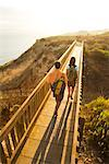 Couple Crossing Walking Bridge, San Pedro, California    Stock Photo - Premium Rights-Managed, Artist: Ty Milford, Code: 700-02200965