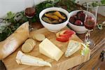 Cheese on a wooden board, pickled fruit and baguette Stock Photo - Premium Royalty-Freenull, Code: 659-02211653