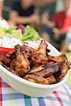 Person holding grilled chicken wings, people in background Stock Photo - Premium Royalty-Free, Artist: Kevin Dodge, Code: 659-02212000