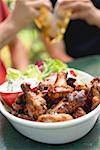 Grilled chicken wings, men with beer in background Stock Photo - Premium Royalty-Free, Artist: Kevin Dodge, Code: 659-02212001
